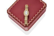 A Lady's gold and diamond Mini-Baignoire wristwatch, Cartier, circa late 1990's. Quartz. Ref: 2368. Case number: GC20508. Oval case with cream dial and painted black Roman numerals, diamond set bezel and bracelet. Case, dial, movement and bracelet signed. 18ct yellow gold. Total weight 69.60 grams. Original box and papers.