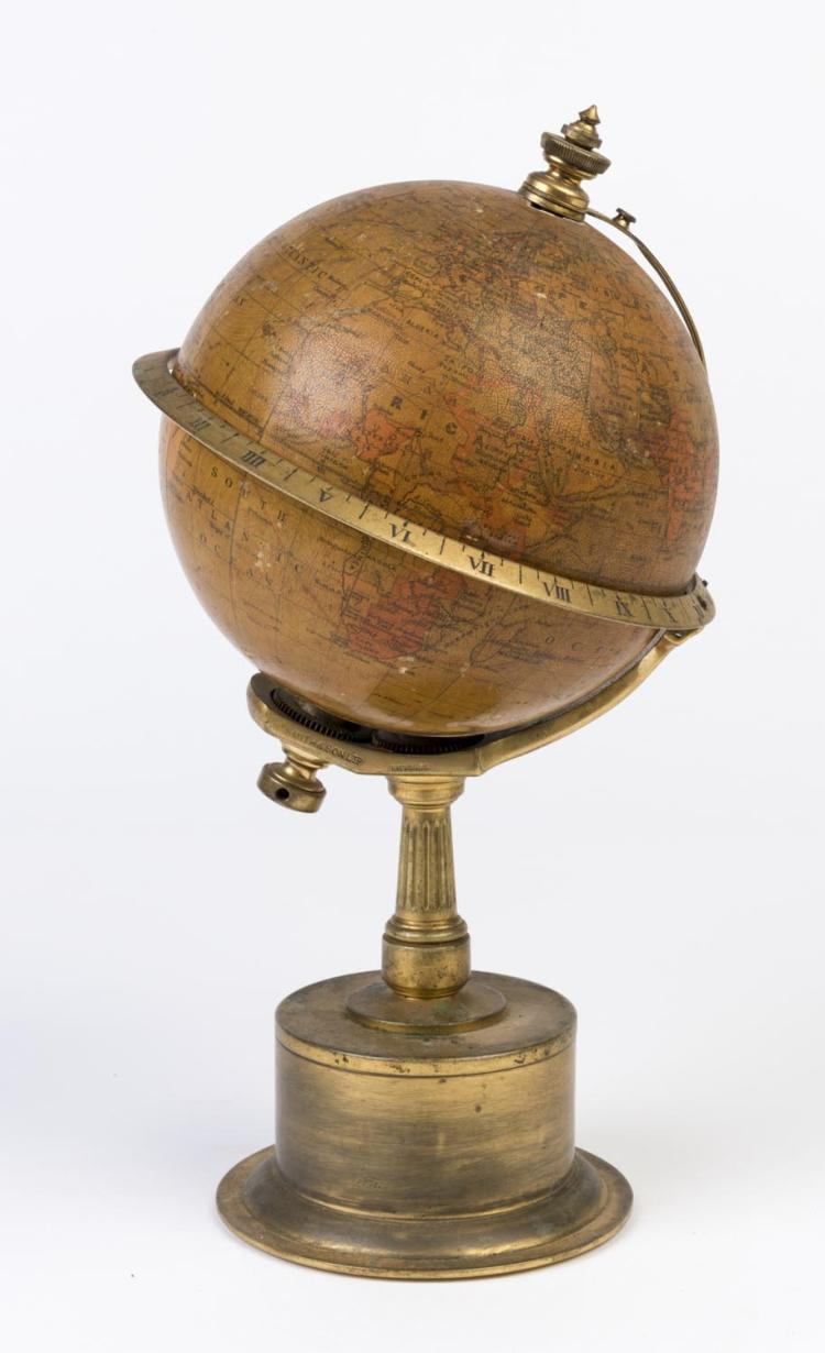 A globe mounted on circular glass stand by Smith and Son Ltd., 19th century inscribed Patent 19460 THE EMPIRE CLOCK