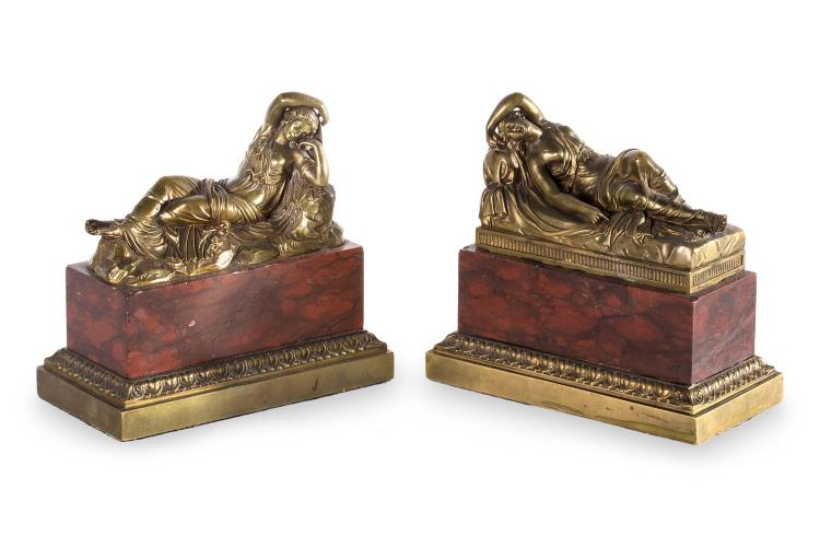 A pair of bronze Grand Tour figures of sleeping nymps, rouge marble bases. 19th century