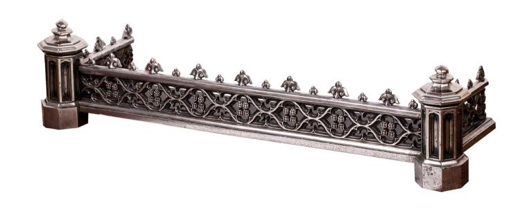 A Gothick fender, polished steel. Irish 19th century29 cm high,128 cm wide, 37cm deepPROVENANCEMallets, Bourdon House
