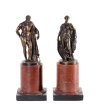 A pair Grand Tour bronze figures on circular rouge marble plinths