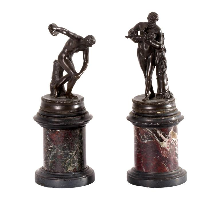 A pair of Grand Tour bronzes of Hercules, one with the infant Telephos, the other with club, on marble plinths. 19th century