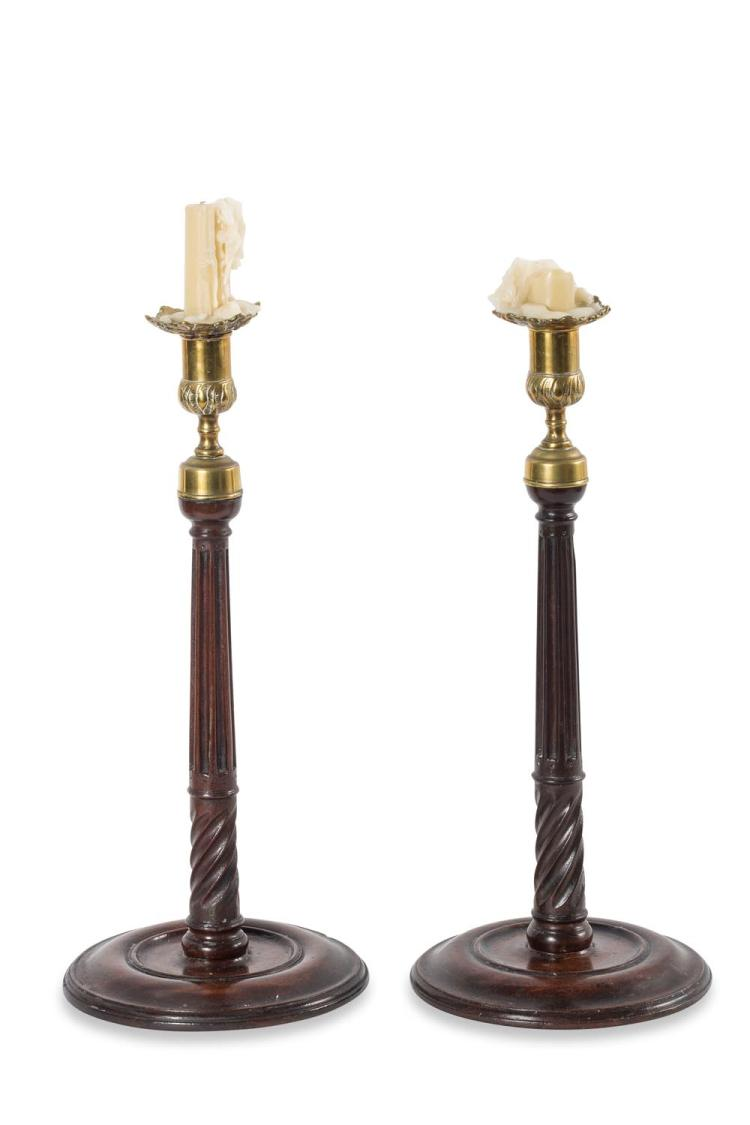 A pair of Georgian style mahogany candlesticks, English