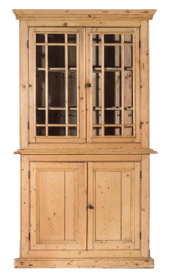 A Georgian pine corner cupboard, English, 19th century