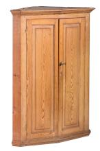 A Georgian pine corner cupboard, English, 19th century
