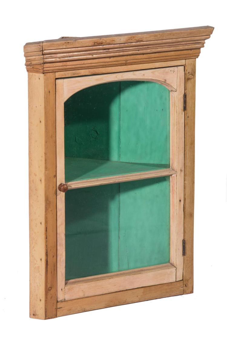 A Georgian pine corner cabinet, English, 19th century