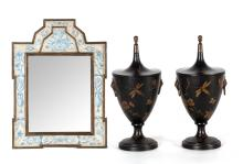 A pair of Tolle chestnut warmers and a framed painted mirror, English, 20th century
