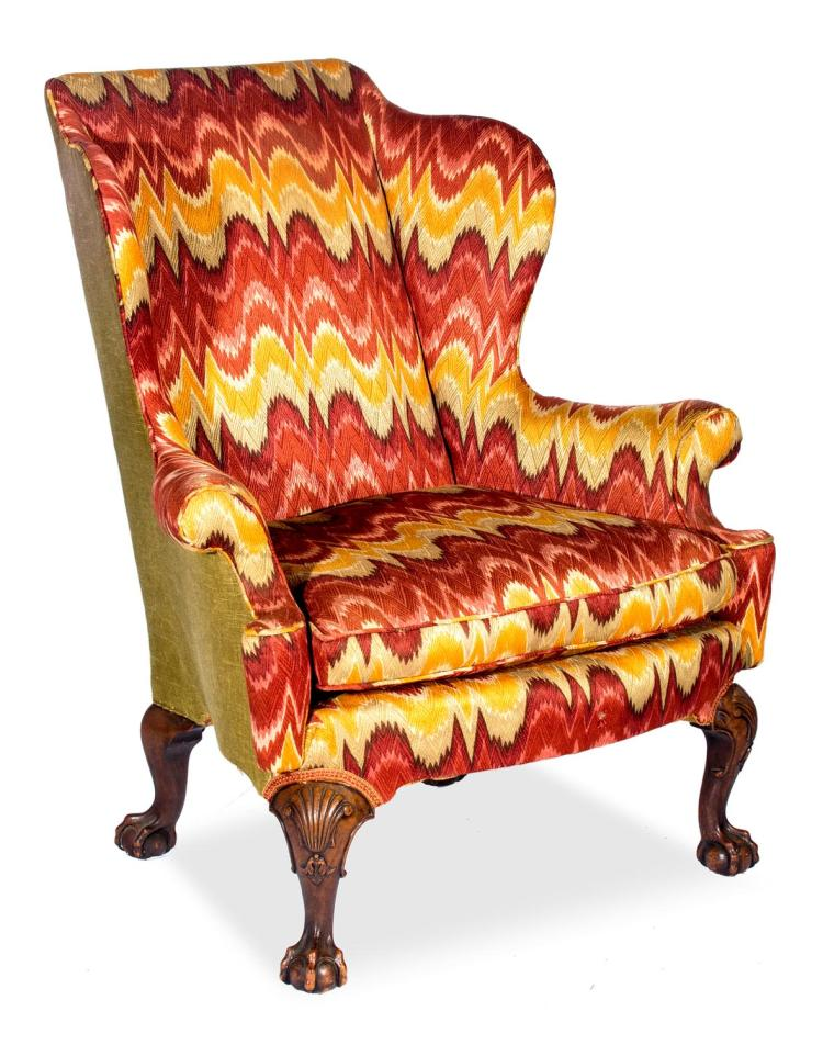 A Georgian style wing armchair, English