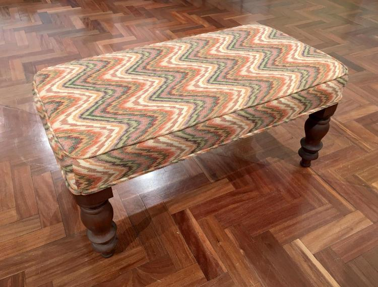A fabric covered ottoman, 20th century
