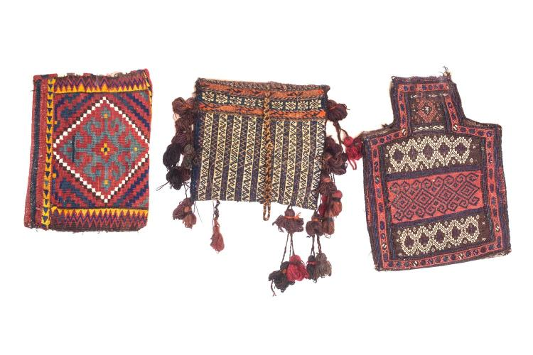 A collection of five tribal saddle bags