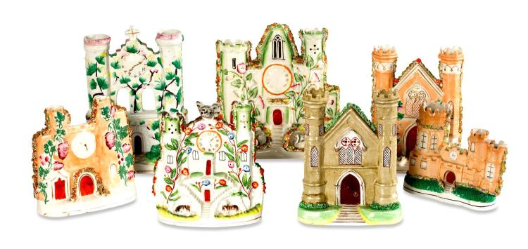 A collection of seven castellated Staffordshire pastille burners, English, 19th century