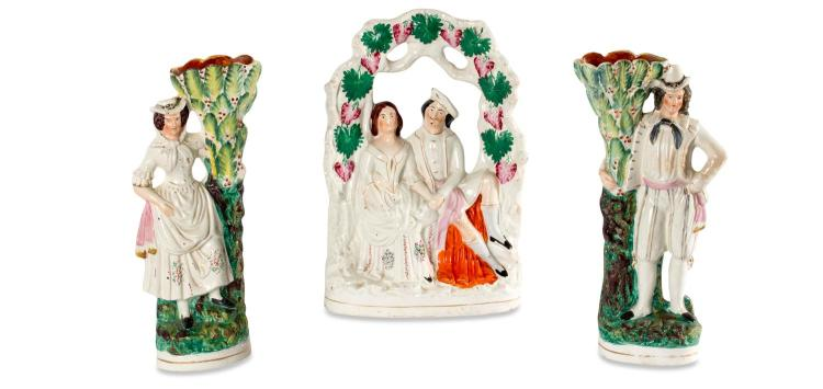 A pair of Staffordshire vases and a Staffordshire flatback, English, 19th century