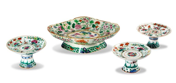 A collection of four famille vert dishes on stand