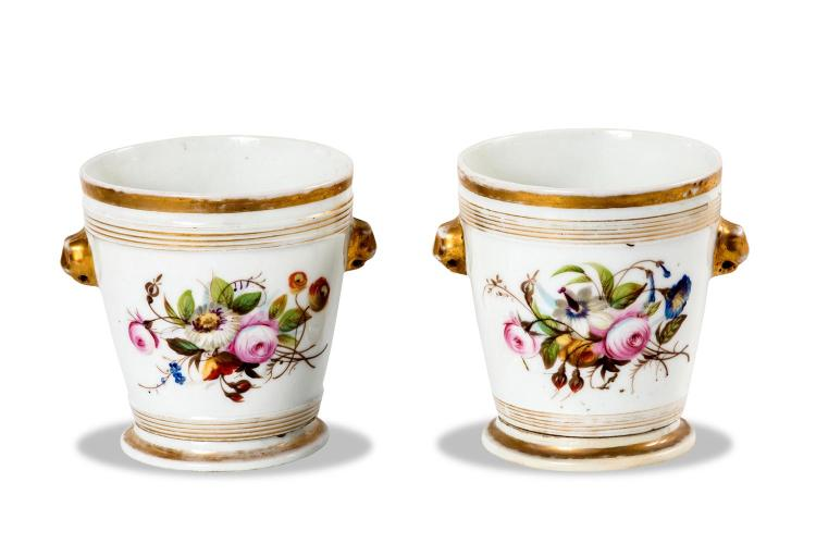 A pair of continental porcelain pots on stands, mid 19th century