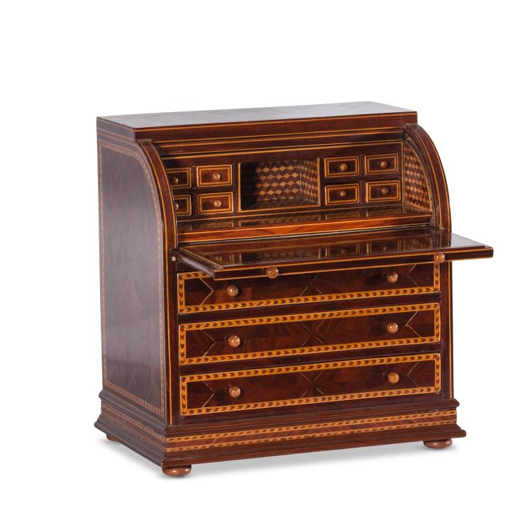 A miniature roll top desk with inlaid timbers, 19th century 28.5 cm high, 27.5 cm wide, 18 cm deep
