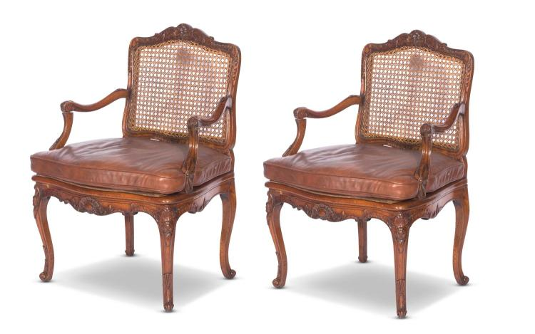 A pair of Louis XV armchairs,stamped Phillipe,French 18th centurycained seat and back with leather cushions,