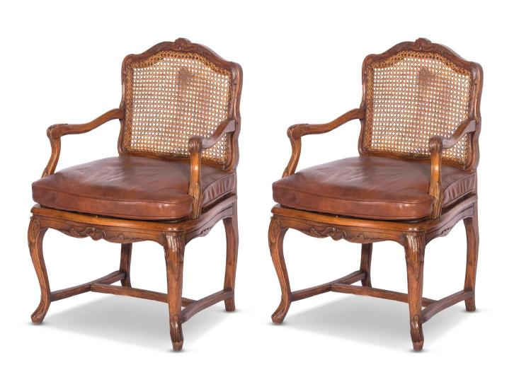 A pair of Louis XV fruitwood armchairs, French 18th centurycained seat and back with leather cushions,