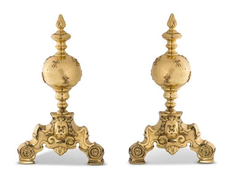 A pair of brass fire dogs, 19th century