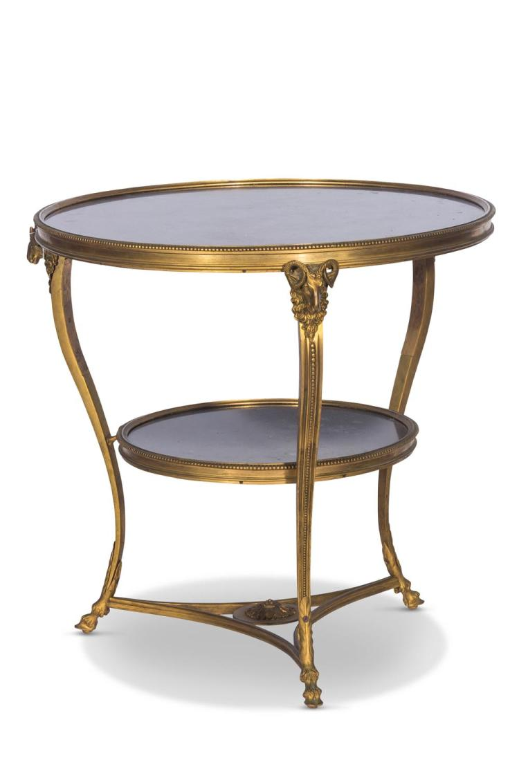 A Louis XVI style gilt metal gueridon, French 20th centurycircular black fossil marble top.  69cm high, 71cm diameter