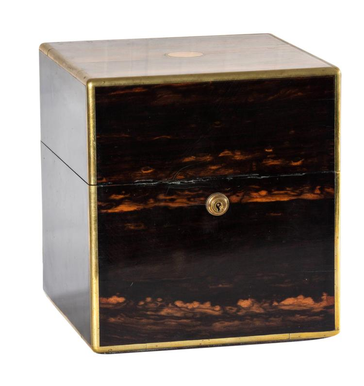 A Regency coromandel wood decanter box with brass mountsEnglish 19th century23 cm high, 21 cm wide, 21 cm deep