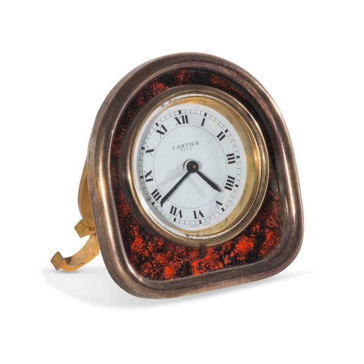A Cartier gilt metal keyless wind alarm clock.serial no. 7504 12638,France, 20th century