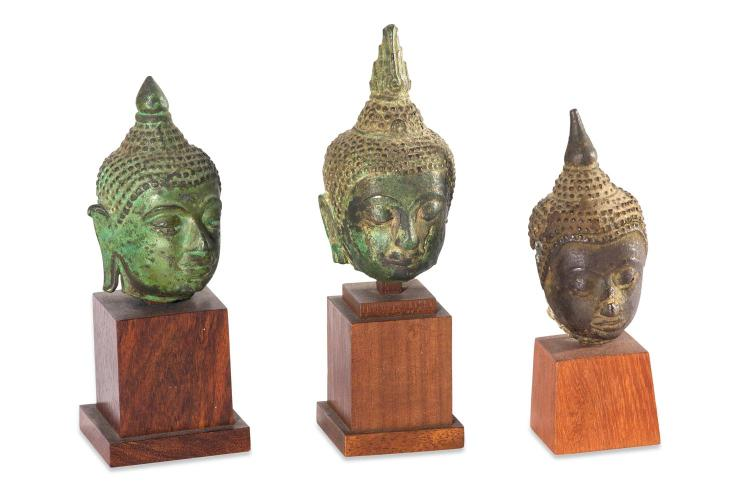 A collection of three Thai buddha heads