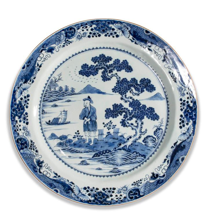A large Chinese Qianlong style blue and white charger 20th century.55.5 cm diameter
