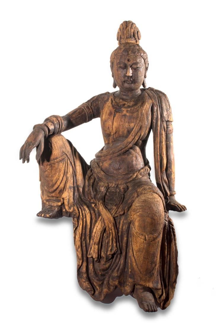 A large Chinese carved wooden figure of Guanyin, 17th century style148cm high
