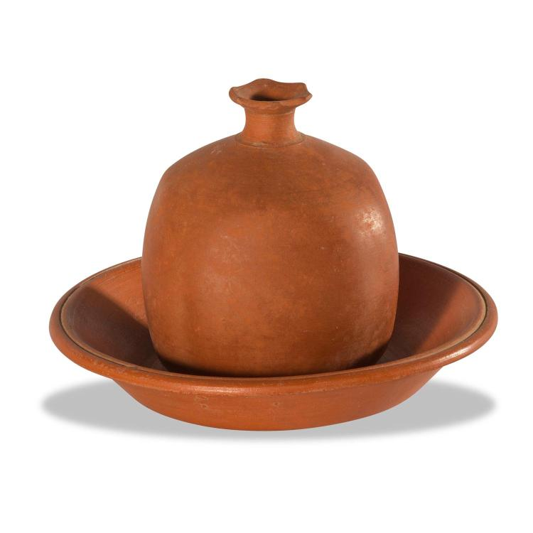 A fine Roman terracotta pomegranate size with dish