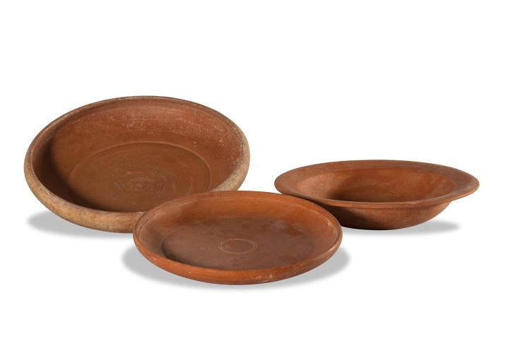 A set of three terracotta round bowls