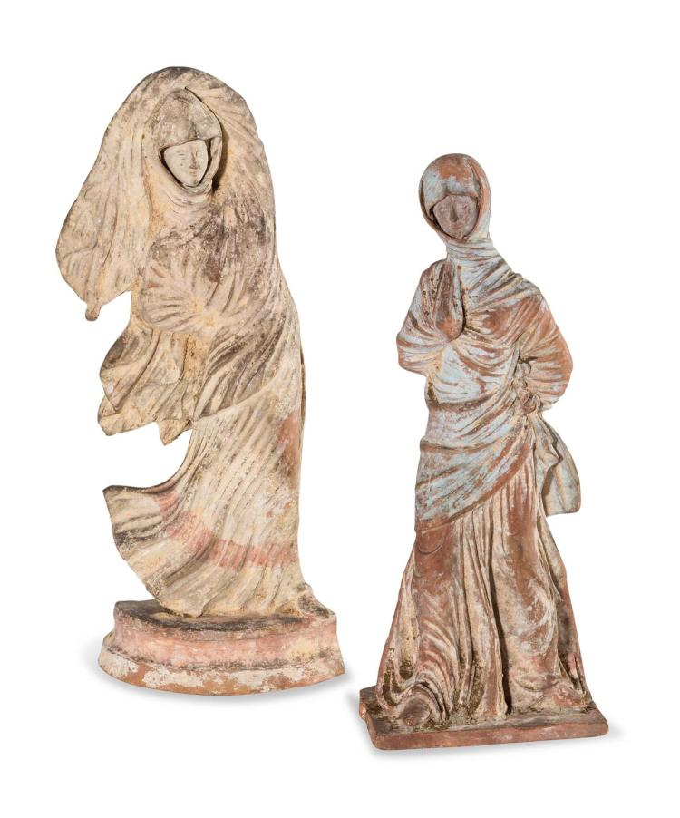 A pair of terracotta figures, after the antique
