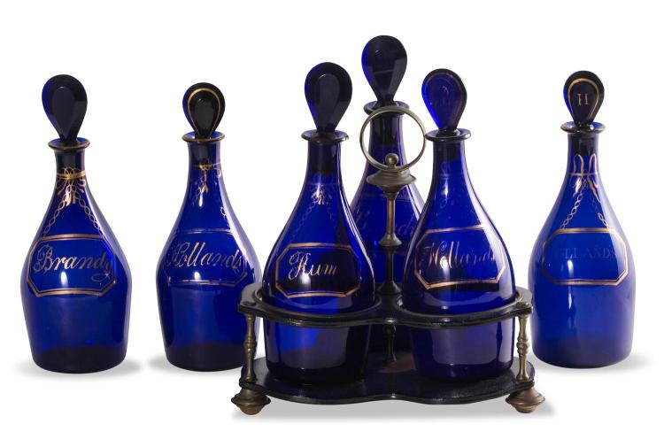 A set of 6 Bristol blue glass decanters and one ebony stand,English, early 18th century 22 cm high