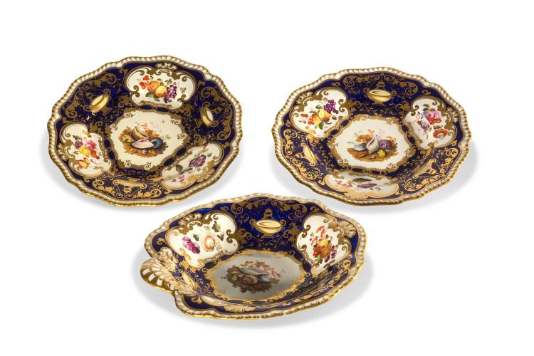 A pair of Staffordshire pottery plates and matching dish painted with seashells, attributed to Harry and Richard Daniel.English, circa 1825