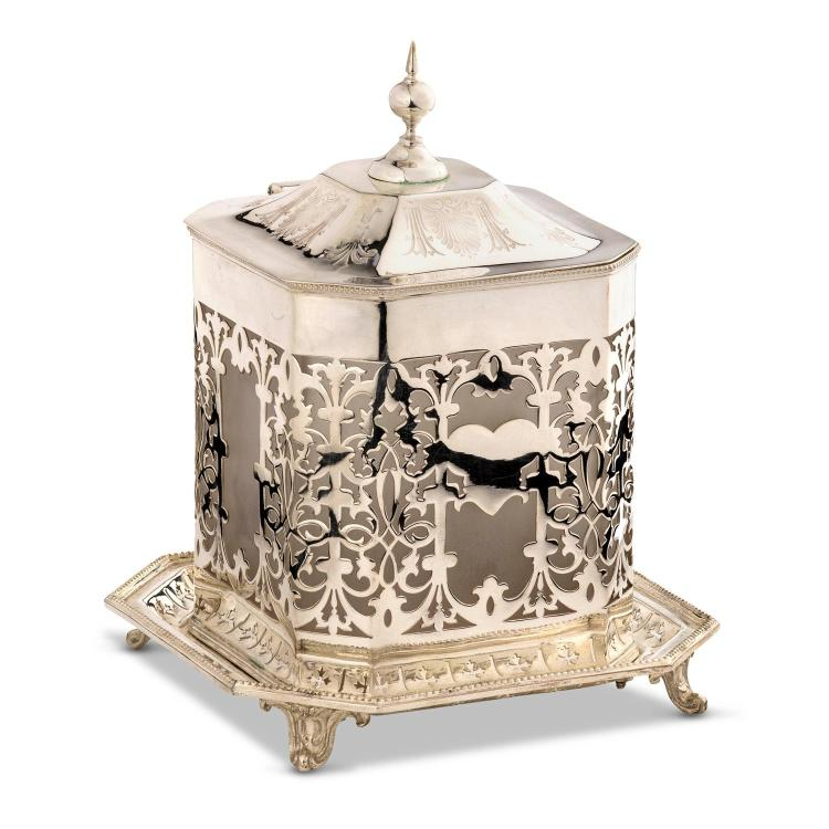 A silver plated biscuit box