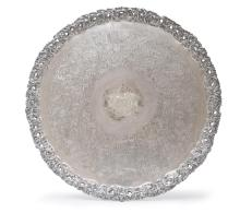 A large William IV Sheffield plate circular traywith pierced rocaille cast border and central armorial cresting60.5 cm diameter