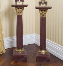 A pair of Louis XV style gilt bronze mounted rouge marble pedestals, late 19th century109.5 cm high, 32 cm wide, 32 cm deep