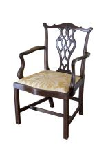 A set of eight George III style mahogany dining chairscomprising of six dining chairs and two carvers, each with a leaf carved pierced splat above drop in seat