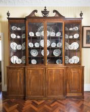 An important George III mahogany library breakfront bookcasewith a pierced swan neck cresting and four astragal glazed doors280 cm high, 246 cm wide, 58 cm deep