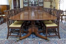 An impressive George IV mahogany four pedestal dining tablewith five leaves, each turned pedestal with leaf carved decoration and four outswept legs72.5 cm high, 550 cm wide, 153 cm deep