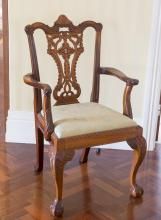 A set of six George III style carved mahogany dining chairs, first half 20th centurycomprising four dining chairs and two carvers each with drop in seats