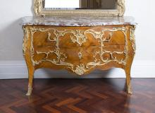 A Louis XV style marble top gilt metal mounted and tulipwood marquetry bombe commode, 19th century, in the manner of Charles Cressent90.5 cm high, 150 cm wide, 64 cm deep