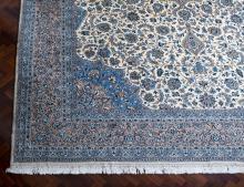 A large Kashan medallion carpet, Iran, 20th centurya central medallion on a floral decorated cream ground505 cm x 352 cmPROVENANCE:Cadry's