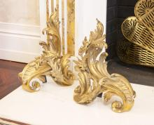 A pair of Louis XV brass rococo style chenet, 19th century41 cm high