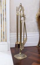 A Victorian pierced brass fan fireguardtogether with a set of brass fire irons on stand68 cm high, 96 cm wide (fan fireguard), 76 cm high (fire irons)