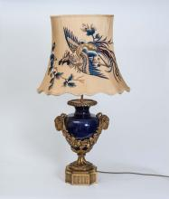 A rams head mask mounted blue porcelain table lamp, in the Adam style, 20th century98 cm high