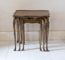 A nest of three carved mahogany occasional tables, 20th century56 cm high, 55 cm wide, 40 cm deep