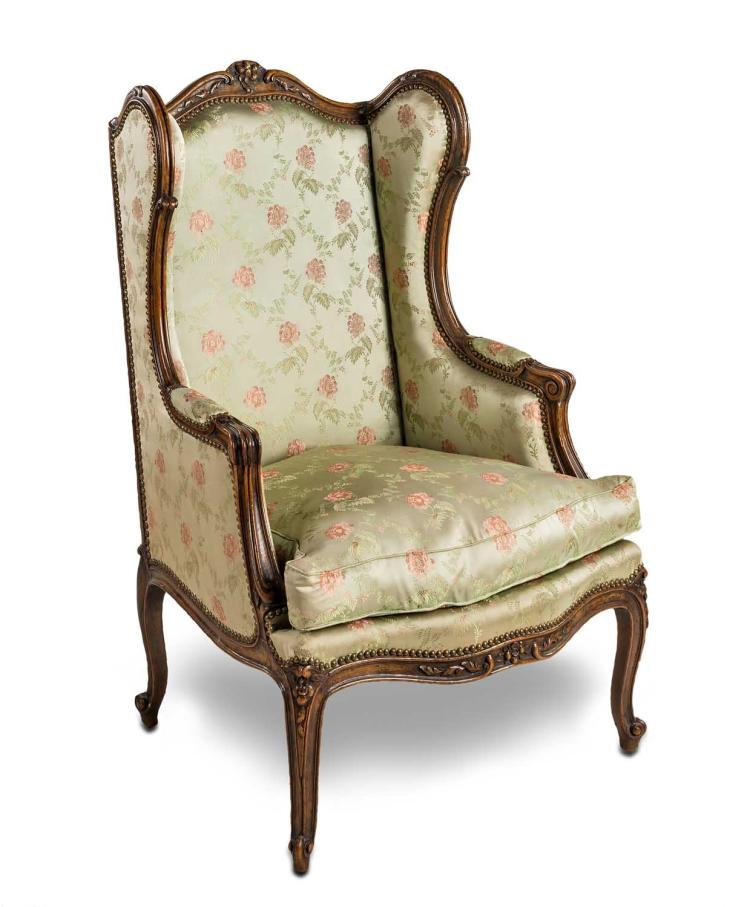 A Carved Walnut Wing Armchair French 19th Century Upholste
