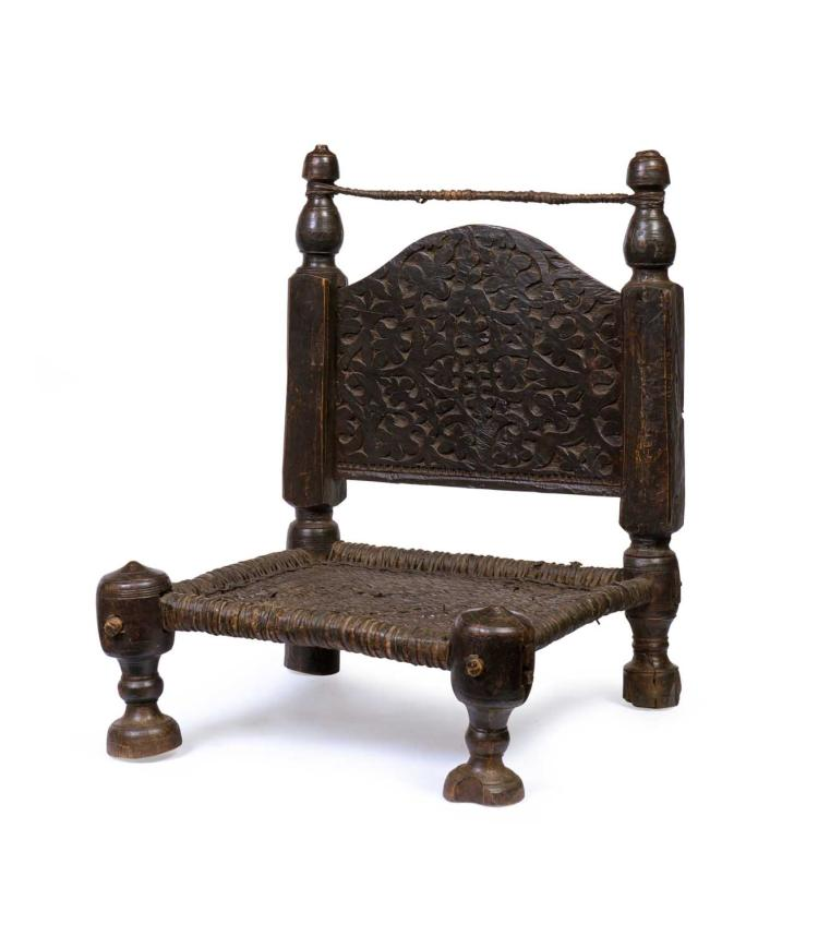 A primitive style low hardwood carved and leather woven chai for Chinese furniture in pakistan