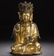 A Chinese gilt bronze figure of Maitreya from Ming Dynsaty