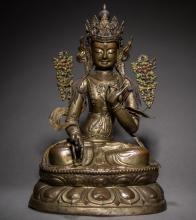 Gilt bronze Han-Tibetan style 18th century Hammered bronze plated silver